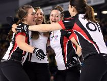 Ontario third Emma Miskew, left to right, skip Rachel Homan, second Joanne Courtney and lead Lisa Weagle celebrate after defeating Manitoba in the gold medal match at the Scotties Tournament of Hearts in St. Catharines, Ont., on Sunday, Feb. 26, 2017. TH