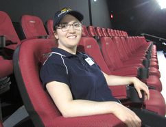"Amy Ferrera, a ""cast member"" at Galaxy Cinemas Sarnia, sits Tuesday in one of the two rows of new D-Box Motion seats, installed on March 10 and now being offered to customers in one of the site's screening rooms. Sarnia's movie theatre is the 70th Cineplex location in Canada to offer the technology. Paul Morden/Sarnia Observer/Postmedia Network"