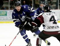 London Nationals' Quinn Lenihan carries the puck against Chatham Maroons' Braden Henderson in the first period at Chatham Memorial Arena in Chatham, Ont., on Thursday, March 16, 2017. Mark Malone/Chatham Daily News/Postmedia Network