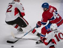 Montreal Canadiens' Paul Byron, centre, squeezes between Ottawa Senators' Dion Phaneuf, left, and Ottawa Senators' Tom Pyatt during first period NHL hockey action in Montreal, Tuesday, November 22, 2016. THE CANADIAN PRESS/Peter McCabe