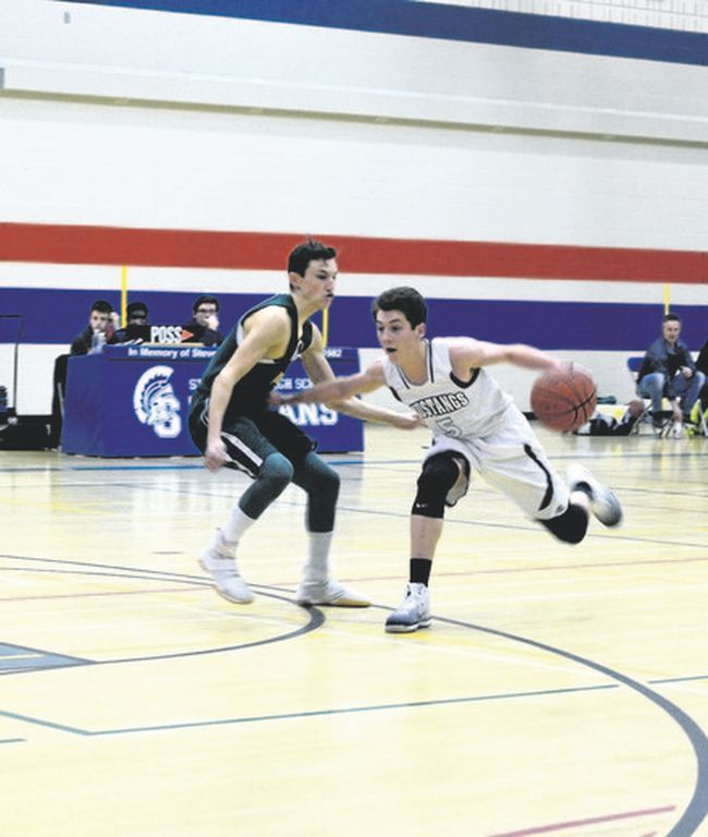 George McDougal High School Mustangs player Caleb Lee Lunges forward towards the Canmore key during the 3A south central zones semi-finals game at Strathmore High School on March 9. The Mustangs won the game 71-69 and would go on to claim the zone title.