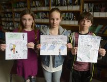 Grade 6 students Kaleigh Doud, Anika Hoff, and Eric Buck from Pilot Butte School in Pilot Butte, Sask., in hold illustrations inspired by Gord Downie's album and graphic novel, Secret Path. The story is about 12-year-old Chanie Wenjack, who died while trying to walk home after running away from residential school in 1966. (MICHAEL BELL/Regina Leader-Post)