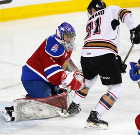 Calgary Hitmen Matteo Gennaro, right, tries to stop score on Edmonton Oil Kings goalie Patrick Dea in WHL action at the Scotiabank Saddledome in Calgary, Alberta, on Sunday, March 12, 2017. The Oil King will conclude their season with a home-and-home series against the Red Deer Rebels this weekend.