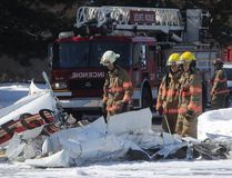 First responders at the scene of a mid air plane accident in the parking lot of the Promenade Saint Bruno shopping centre on Friday March 17, 2017. One of the plane crashed in the parking lot while the other on the roof of the mall. (Pierre Obendrauf/POSTMEDIA)