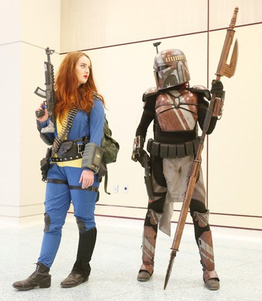 Ann Davis as Sole Survivor from the video game FallOut4 and Danica Sherman as a Xekiah Priest, a Mandalorian Star Wrs bounty hunter at Toronto Comicon 2017 held at the Metro Toronto Convention Centre until Sunday on Saturday March 18, 2017. Jack Boland/Toronto Sun/Postmedia Network