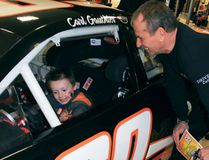 Sean Chase/Daily Observer Carl Gauthier looks on as six-year-old Lucas Palmer goes behind the wheel of the 2017 Chevy Impala that Gauthier will be racing at Canadian Tire Motorsport Park in Bowmanville, Ontario on May 21.