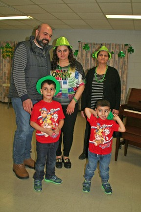 Celebrating their first St. Patrick's Day in Canada, (back) Sharif Al Nassad and Abeer Allias, Abeer's mother and the children George and Joseph. They are among the 40,000 Syrians resettled in Canada.(Submitted photo)