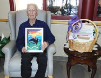Photo by Helen Morley/For The Mid-North Monitor Fred Bright, admires one of his birthday cards created by 13-year-old Ezrie Lafrance. Fred turned 100 years old on March 17.