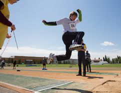 Jared Larsen competes in the long jump during Special Olympics Alberta-Edmonton Track and Field Meet at Foote Field in Edmonton, on June 12, 2016.