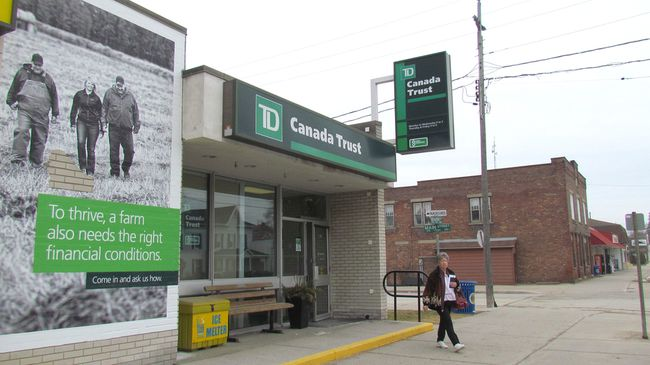 A customer leaves the TD Canada Trust branch Monday in Wyoming, Ont. The branch is scheduled to close in July, ending more than a century of service by the bank in the central Lambton County community. (Paul Morden/Sarnia Observer)
