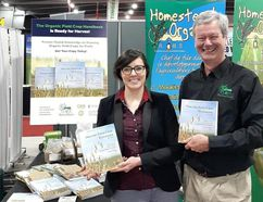 <p>COG's Ashley St. Hilaire and Homestead Organics' Tom Manley at the Ottawa Farm Show in March 2017. They launched the third edition of the Organic Field Crop Handbook at the show.</p><p> Handout/Cornwall Standard-Freeholder/Postmedia Network