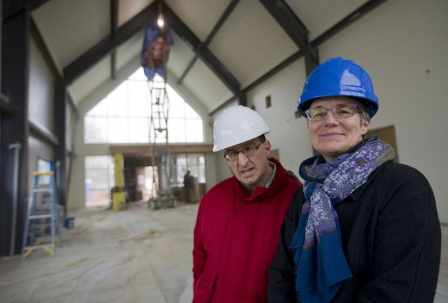 Marietta Drost, executive director of L'Arche London, and member Jim McGeough tour a new facility under construction on Col. Talbot Road in Lambeth Monday. Called the Gathering Place, the 740-square-metre facility will allow L'Arche to double its day programs for adults with developmental disabilities. (MIKE HENSEN, The London Free Press)