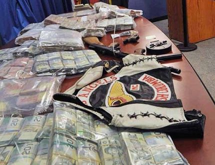RCMP announce seizures as a result of a raid of the Kelowna Hells Angels clubhouse as part of Operation E-Predicate. (Wayne Leidenfrost/Postmedia Network)