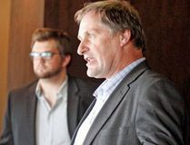 Timiskaming-Cochrane MPP John Vanthof speaks about Northern transportation in North Bay earlier this month while Jordan Andrews, president of the Nipissing University Student Union, listens in the background. GORD YOUNG/NORTH BAY NUGGET
