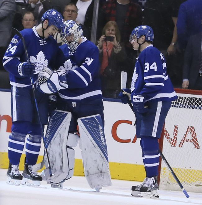 Toronto Maple Leafs goalie Frederik Andersen (31) is surrounded at the end of the game by Toronto Maple Leafs center Brian Boyle (24)and Toronto Maple Leafs center Auston Matthews (34) on Monday March 20, 2017. The Toronto Maple Leafs hosted the Boston Bruins at the Air Canada Centre in Toronto. Veronica Henri/Toronto Sun/Postmedia Network