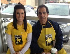 Dana Crispo, an ovarian cancer survivor, and her father, Albert Crispo, sell daffodil pins last April in support of the Canadian Cancer Society. Supplied photo
