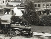 PHOTO COURTESY OF THE MUSEUM OF THE HIGHWOOD. A dog strolls along platform beside a steam train in High River, 1925.
