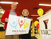 Sudbury YMCA volunteers Gary Gray and Millie Facca display a new 75th anniversary logo unveiled at the launch of YMCA Sudbury's 75th anniversary celebrations on Tuesday, March 8, 2011.