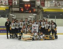 he Vermilion Lakeland College Bantam Tigers with their NEAHL banner. Submitted Photo.