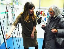 PAUL KRAJEWSKI HIGH RIVER TIMES/POSTMEDIA NETWORK. At the Town of High River's Registration Roundup on March 11, Active Neighbourhoods Canada unveiled potential local infrastructure projects aimed at promoting active transportation. Celia Raven Lee, lead facilitator for the organization, explains how these projects will help the community become more vibrant and active to Marguerite Brandon, an MD of Foothills resident, during the event that was held at the Bob Snodgrass Recreation Complex.