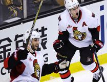 Senators centre Kyle Turris (right) celebrates after his go-ahead goal, breaking a 2-2 tie, against the Bruins during third period NHL action in Boston on Tuesday, March 21, 2017. At left is Senators centre Derick Brassard. (Charles Krupa/AP Photo)