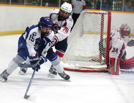 Sudbury Nickel Capital Wolves' Parker Savard fends off North Bay Trappers` Eric Mondoux during Game 4 of the Great North Midget League championship final at Gerry McCrory Countryside Sports Complex, Tuesday. Gino Donato / Postmedia
