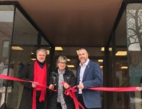 Sarnia Mayor Mike Bradley, Lilith Boutique owner Chris Yurchuk and Sarnia Coun. Brian White cut a red ribbon during Lilith Boutique's grand re-opening on March 3rd. handout/Sarnia This Week