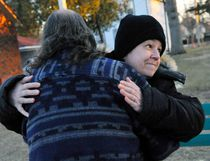 Margie King gets a hug from Don Stackhouse at a vigil Tuesday night to remember Delhi resident Sally Ann Dollard, the 72-year-old victim of a fatal hit-and-run in Delhi on March 17, 2017. JACOB ROBINSON/Simcoe Reformer