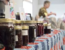 Canned jams and jellies line the front of a vendor booth at the Peace River Farmers' Market on Saturday March 18 in Peace River.