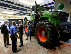 """Farmers congregate at the London Convention Centre for the Grain Farmers of Ontario Convention on Tuesday. The group is studying the economic impact of the province's """"rash"""" ban on neonics and has launched a PR campaign. (MORRIS LAMONT, The London Free Press)"""