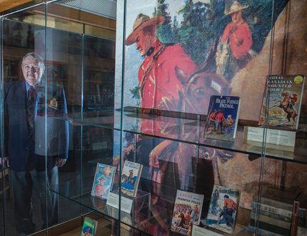 Retired RCMP Staff Sgt. Al Lund spent 50 years collecting Mountie books, comics and magazines. He donated the collection to the U of A libraries and a new exhibition at the Bruce Peel Special Collections in U of A's Rutherford Library is showcasing 100 of his favourite items until July. He flew to Edmonton last week to visit the exhibit and is seen here last Friday. Shaughn Butts, Postmedia Network