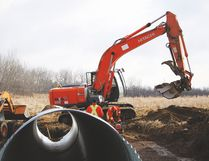 A Vulcan County crew works on a culvert bridge work northeast of Vulcan Feb. 23. By doing the work internally, the County saves a significant amount of money on such projects. Stephen Tipper Vulcan Advocate
