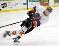 A Portage skater gets tripped up during the Islanders' 3-0 Game 2 victory last week at Stride Place. The Islanders can take a demanding 3-1 series lead with a win Thursday night in Portage la Prairie.