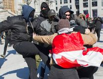 Opposing groups of protesters clash during a demonstration regarding motion M-103 in Montreal, Saturday, March 4, 2017. (THE CANADIAN PRESS/PHOTO)