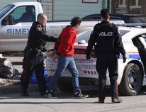 Greater Sudbury Police arrest a male on Albert Street following a weapons complaint. At least five people were taken into custody at the scene. John Lappa/The Sudbury Star/Postmedia Network