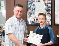 Brandon Tronchin (right) received the March Youth of the Month award for his insightful comments in his journal entries at École J.E. Lapointe School. The youth was given the award and $100 prize from Camille Bérubé (left).