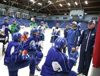 The Sudbury Wolves coaching staff goes through instructions with their players at practice ahead of Friday's playoff opener against the Generals in Oshawa. Gino Donato/The Sudbury Star