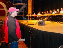 Luke Hendry/The Intelligencer Stirling-Rawdon resident Mark Collins addresses politicians and police during a meeting about the municipality's policing future Wednesday at the Stirling Festival Theatre. Council must decide by July 23 whether to request OPP service or await a revised costing estimate.