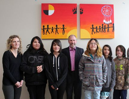 """The artwork of six St. Louis School students, titled """"Together"""", was unveiled on Wednesday, March 22 in the Northwestern Health Unit lobby. From left to right: artists Holly Ann Friesen, Ayiana Payash, Hannah Anderson, Northwestern Health Unit CEO Mark Perrault, Alayna Dunsford, David Wayne Doucette, Nathan Slaney and learning resource teacher Marnie Buffett. A sixth student, Unique Paypom, was unable to attend the unveiling. Kathleen Charlebois/Daily Miner and News"""