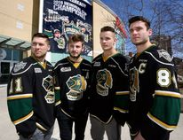 London Knights Owen MacDonald, left, Victor Mete, Tyler Parsons and captain JJ Piccinich show their game faces in front of Budweiser Gardens on Thursday with their OHL playoff opener against the Windsor Spitfires looming on Friday night. (MORRIS LAMONT, The London Free Press)