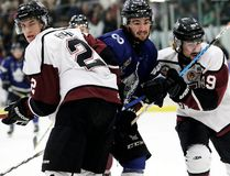 London Nationals' Michael Andlauer is sandwiched by Maroons Dakota Bohn, left, and Blair Derynck during the first period of Game 5 of the GOJHL Western Conference semifinal at Chatham Memorial Arena on Thursday night. The Nats clinched the series with a 6-1 victory. (MARK MALONE, Postmedia News)