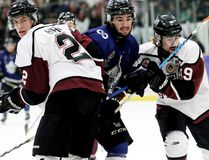 London Nationals' Michael Andlauer is sandwiched by Chatham Maroons' Dakota Bohn, left, and Blair Derynck during the first period of the Nationals' 6-1 win in Game 5 of their GOJHL Western Conference semifinal at Chatham Memorial Arena on Thursday, March 23, 2017. (MARK MALONE/The Daily News)