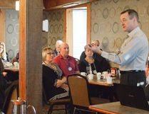Rob Devitt, right, supervisor with the Chatham-Kent Health Alliance, talks to members of the Rotary Club of Chatham Sunrise at their weekly meeting March 21. It's one of numerous community engagement initiatives the CKHA has started, part of reestablishing trust and transparency with residents of Chatham-Kent.