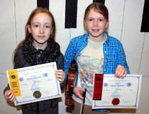 Sean Chase/Daily Observer Competing in the 69th annual Pembroke Kiwanis Music Festival were Maude Wright (left), of Jeanne-Lajoie, who took first place in the violin solo general achieving 88 per cent, and Ciella Fitch, from L'Ecole Equinoxe, who placed second in the violin solo general (80 per cent).