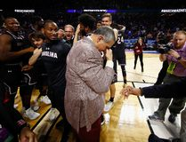 Head coach Frank Martin of the South Carolina Gamecocks reacts after defeating the Duke Blue Devils 88-81 in the second round of the 2017 NCAA Men's Basketball Tournament. It is a similar reporter action Jonathon Brodie made 1,500 kilometres away when he found out Duke lost and his bracket was busted. (Photo By Gregory Shamus, Getty Images)