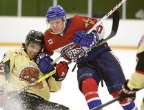 Rayside Balfour Canadians Cayse Ton and Blind River Beavers Anthony Bastianello battle for the puck during NOJHL playoff action in Sudbury, Ont. on Sunday March 19, 2017. Gino Donato/Sudbury Star/Postmedia Network