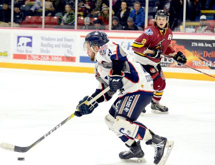 Cochrane Crunch forward Braeden Cross, shown here carrying the puck through the neutral zone towards the Timmins blue-line as Rock defender Nicholas Hautanen looks on, is in the dog house. After registering 82 points to lead the NOJHL in scoring during the regular season, Cross has yet to record a point in three playoff games. It remains to be seen if he will be in the lineup Saturday night when the two teams play Game 4 of their best-of-seven East Division semifinal series at the McIntyre Arena. THOMAS PERRY/THE DAILY PRESS