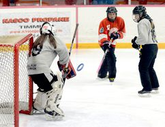 Jayme Marcotte, of the Porcupine Kinsmen, gets a backhand shot off on Valley East goalie Katrina Locking as Valley East defender Kaitlyn Hinksman looks on during the first half of a Tween Division game at the McIntyre Arena Friday morning. The Kinsmen and Valley East battled to a 6-6 draw in the first game for each at the Northeast Regional Ringette Championships. The event will continue through the weekend, with the championship games to be played on Sunday. THOMAS PERRY/THE DAILY PRESS