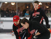 Widdifield Wildcats curlers Tanner Johnson, Andrew Hong and Will Patterson compete in the OFSAA provincial quarterfinals at the North Bay Granite Club, Friday. Dave Dale / The Nugget