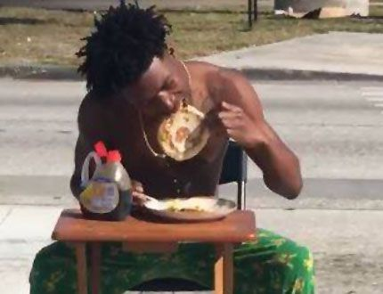 Photos show a man, identified by police as Kiaron Thomas, eating pancakes in the middle of the street. (LakelandPD/HO)